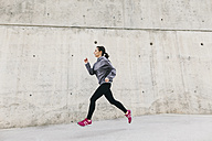 Spain, Barcelona, jogging woman - EBSF001208
