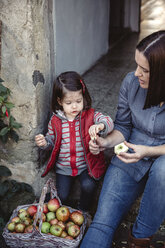Mother and her little daughter with fresh harvested organic apples - DAPF000001