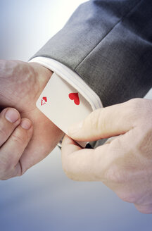 Business man, playing card with heart and ace - GUFF000192
