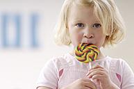 Portrait of little blond girl with lollipop - GUFF000207