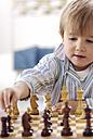 Portrait of little boy playing chess - GUFF000213