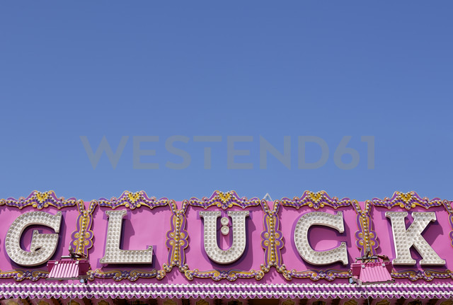 Germany, the word 'Glueck' on a raffle ticket booth in front of blue sky - GUFF000216
