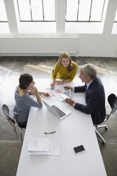 Businessman and two women in conference room having a meeting - RBF004040