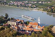 Austria, Wachau, Duernstein, Duernstein monastery with blue spire at Danube river - AIF000255