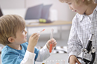 Two little boys playing with utensils of chemical laboratory - GUFF000236
