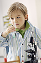 Portrait of little boy with test tube and microscope - GUFF000242
