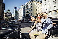Austria, Vienna, couple on sightseeing tour in a fiaker - AIF000266