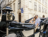 Austria, Vienna, couple in love on sightseeing tour in a fiaker - AIF000269