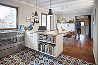 Man in open plan kitchen - RHF001242