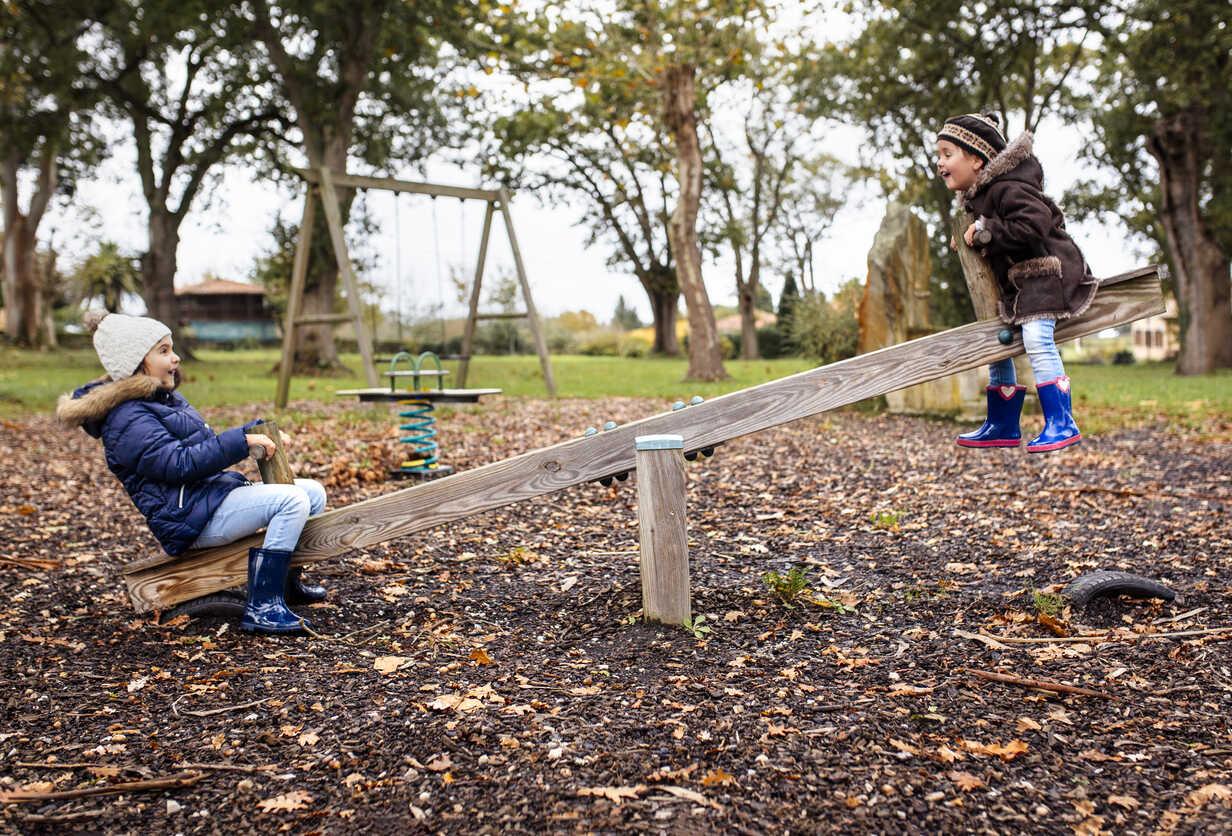 Two little girls having fun on a rocker  in autumn - MGOF001240 - Marco Govel/Westend61