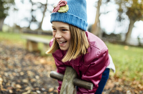 Portrait of happy girl on a playground in autumn - MGOF001249