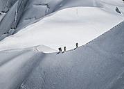 France, Chamonix, Mont Blanc Range, mountaineers at Aiguille du midi - ALRF000322