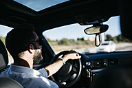 Young man driving a car - JRFF000312