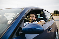 Young man driving a car - JRFF000318