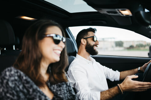 Young couple driving in a car - JRFF000321