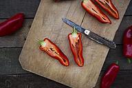Chopped red pointed pepper on chopping board, halved, pocket knife - LVF004399
