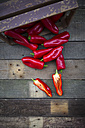 Red pointed peppers, wooden box, halved - LVF004402