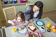 Mother and her little daughter at breakfast table - HAPF000112