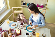 Mother and her little daughter at breakfast table - HAPF000118