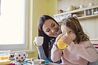 Mother and her little daughter together at breakfast table - HAPF000121