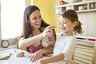 Mother and her little daughter having fun together while they are baking - HAPF000142