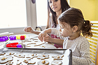 Portrait of little girl baking together with her mother - HAPF000154