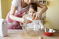 Mother and her little daughter baking together - HAPF000160