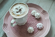 Cup of white coffee with chocolate shaving and meringues on a plate - ASCF000458