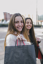 Portrait of happy young woman with shopping bags - MGOF001270