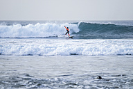 Spain, Tenerife, Boy surfing on ocean - SIPF000059