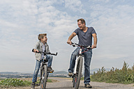 Germany, Rhineland-Palatinate, little boy on bicycle tour with his father - PAF001527