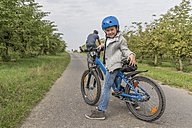 Portrait of little boy on bicycle tour with his father - PAF001530