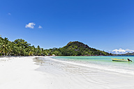 Seychelles, Praslin, Anse Volbert, motorboat on beach - FOF008395