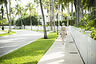 USA, Florida, Key West, woman walking on sidewalk - CHPF000205