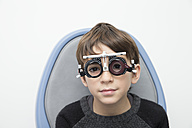 Boy wearing eye test equipment - ERLF000100