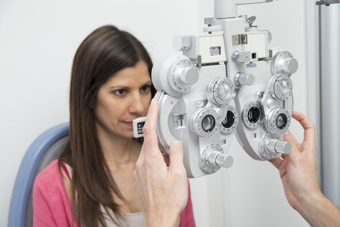 Woman at the optometrist making an eye test - ERLF000111