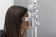 Woman at the optometrist making an eye test - ERLF000114