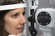 Woman at the optometrist making an eye test - ERLF000117