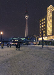 Germany, Berlin, view to television tower at snow fall in the evening - ZMF000451
