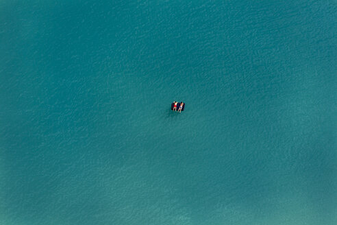Aerial view of two bathers on airbeds, swimming lake - KLE000040
