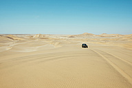 Namibia, Namib desert, Swakopmund, 4x4 car driving among the dunes in the desert - GEMF000640