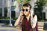 USA, New York City, Williamsburg, portrait of tattooed young woman with headphones - GIOF000703