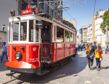 Turkey, Istanbul, Beyoglu, tourists and historical tram on Istiklal Avenue - MDI000008