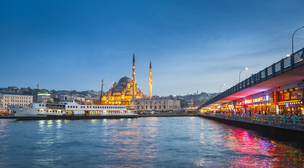 Turkey, Istanbul, view to Eminonu Harbor and New Mosque in the background at blue hour - MDI000014