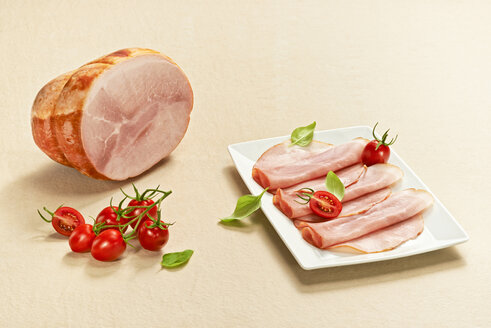 Slices of cooked ham on plate - DIKF000180