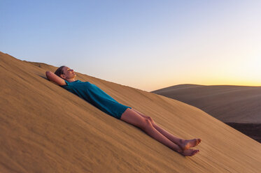Woman relaxing on dune - DIGF000036