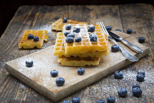 Stack of waffles with icing sugar and blueberries - LVF004449