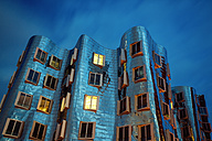 Germany, Duesseldorf, facade of Gehry house at twilight - TAM000358