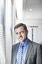 Portrait of confident businessman at the window - ZEF007981