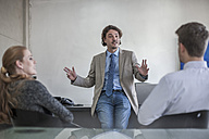 Businessman talking to colleagues in office - ZEF008002